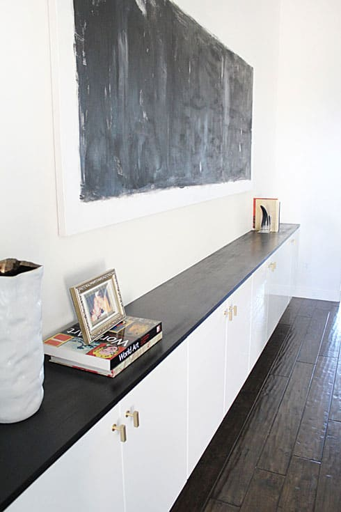 Chic Ikea Hacks - These gold pulls give this Ikea floating cabinets an extra classy look!