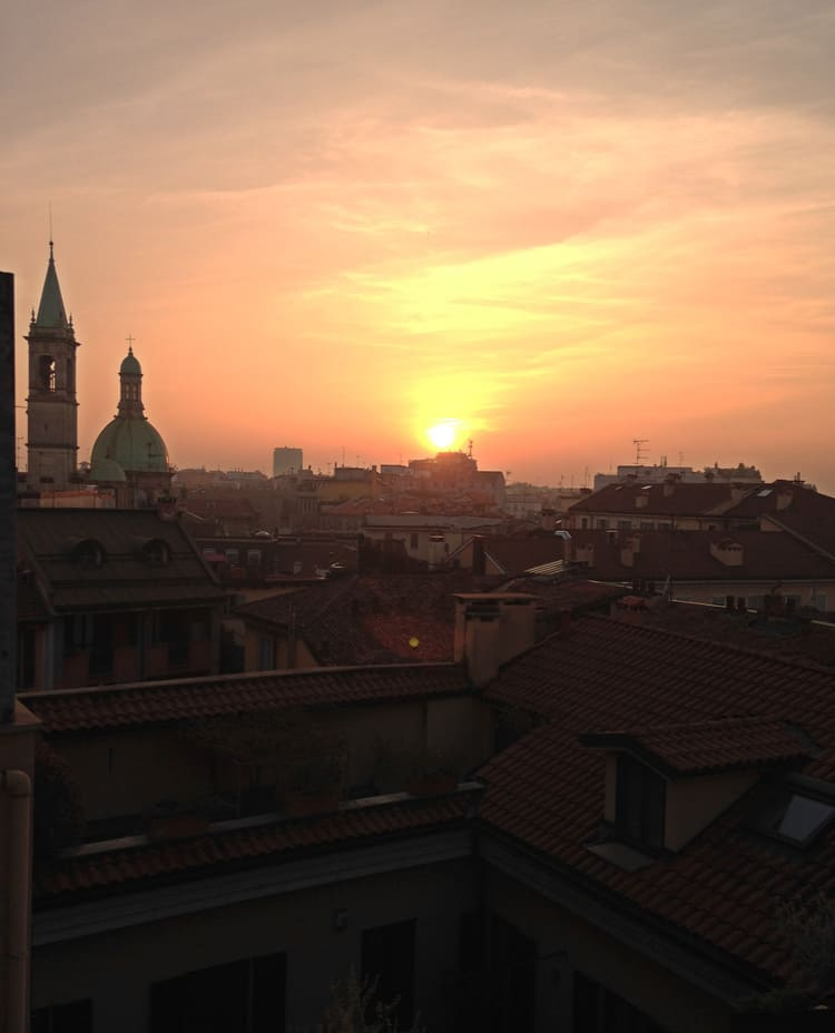 Travel Diary Milan: the red roof tops of the city at sunset