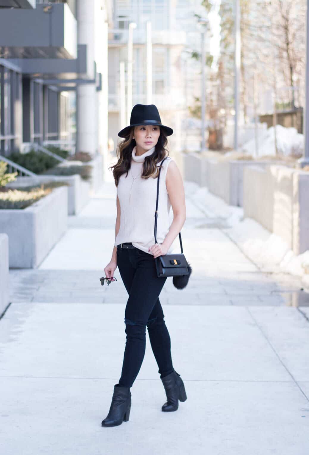 Street style look with rag and bone ripped denim, boots and hat, Ferragamo bag, Aritzia sweater, ray-bans