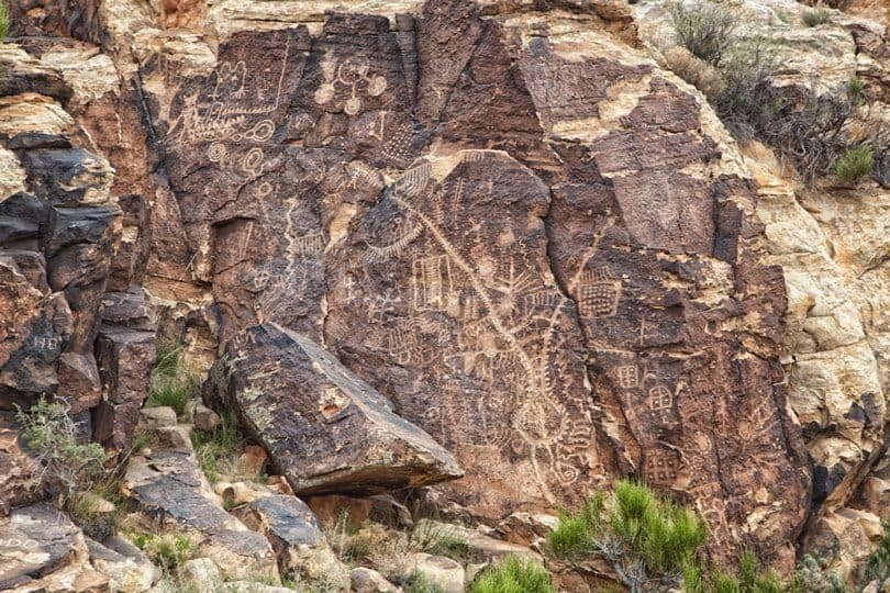 The different cultures are evident by the hundreds of petroglyphs carved into the Parowan Gap. T