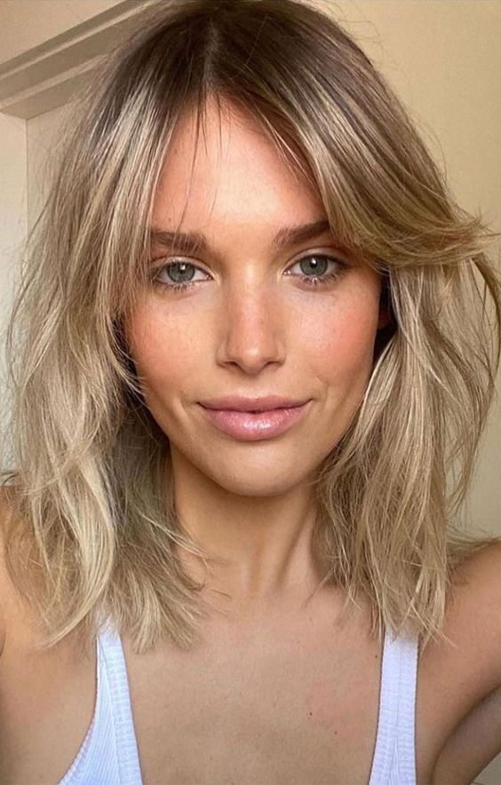 Medium hairstyles for women - A long bob with curtain bangs is a great haircut that looks good on different face shapes!