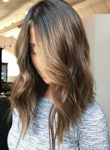 A long lob with an angle cut looks so chic and modern!