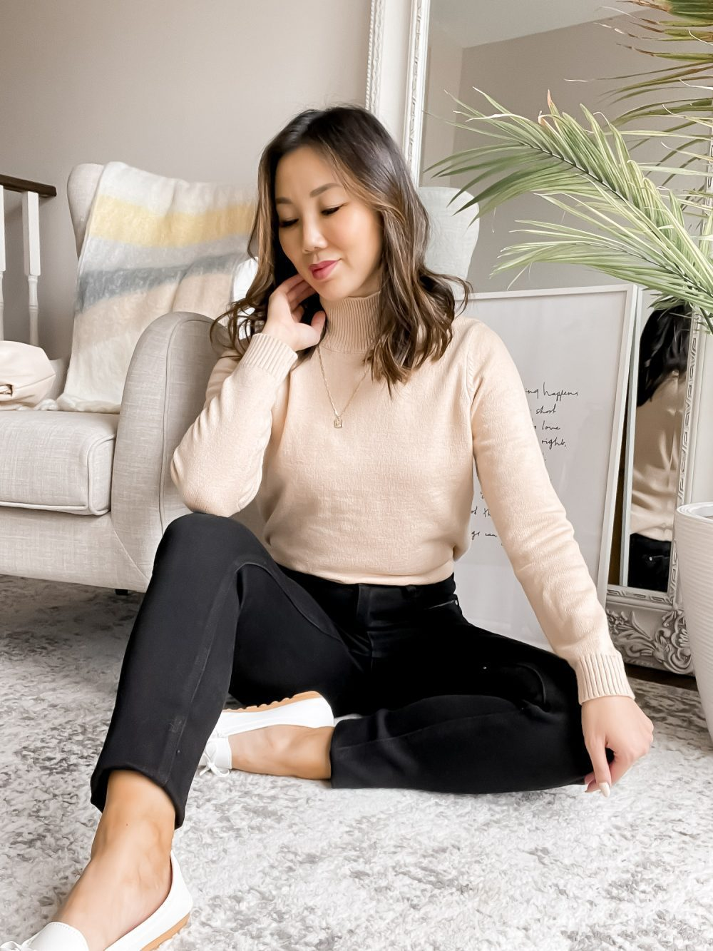 The perfect everyday casual fall outfit with a tan turtleneck sweater, black jeans and loafers. See more fall outfit ideas on yesmissy.com