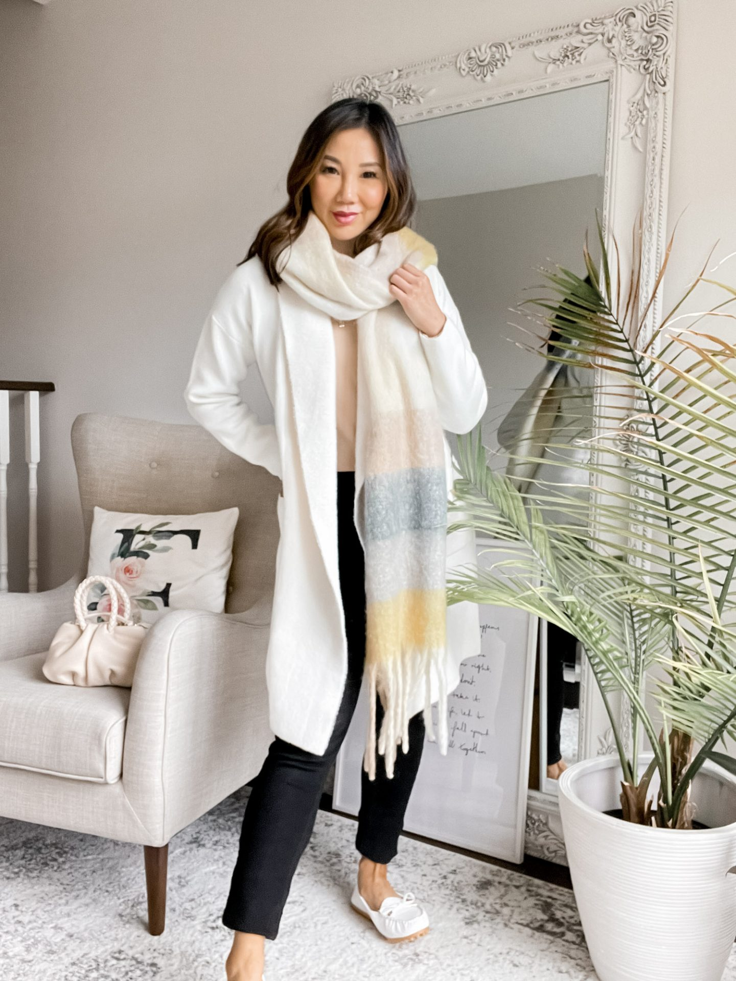 Time to get cozy! This coatigan is the perfect layering piece for fall and winter. Staying cozy in this casual fall outfit layered with a knit scarf and tan sweater. Styled by Eileen Lazazzera of yesmissy.com