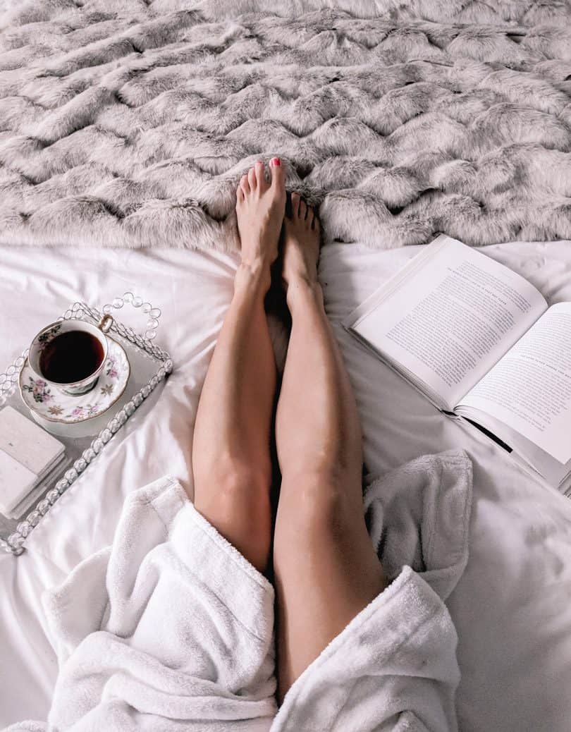 Getting cozy for some R&R time in bed with a book and tea