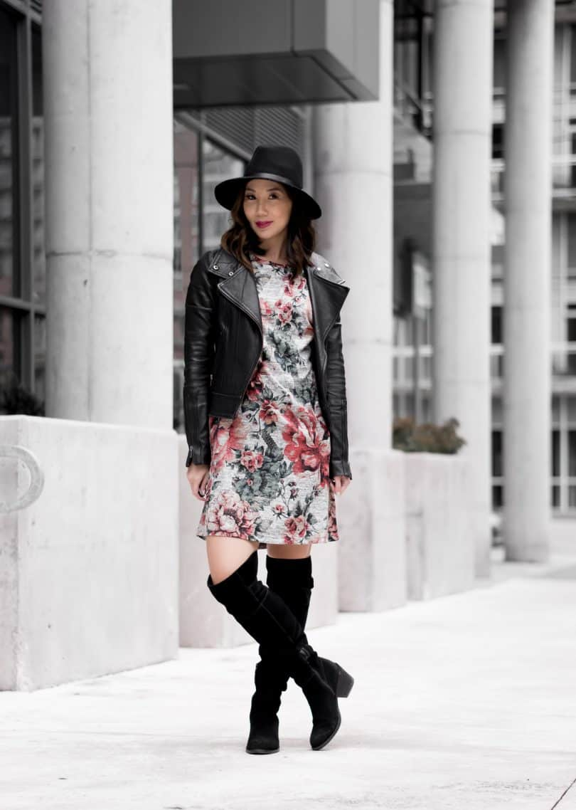 Fall look with floral dress, OTK boots, and leather jacket