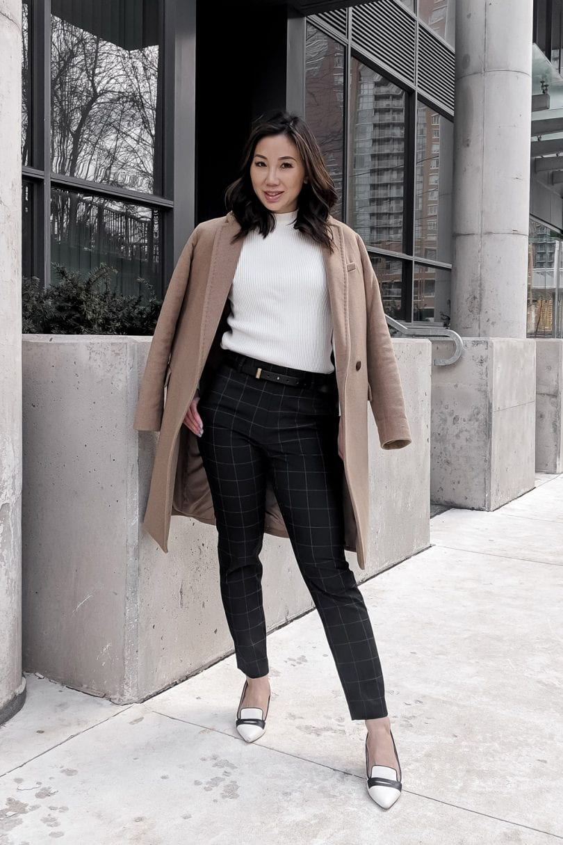 Fall and Winter trends: outfit inspiration - camel coat, checkered pants, white sweater, contrast pumps