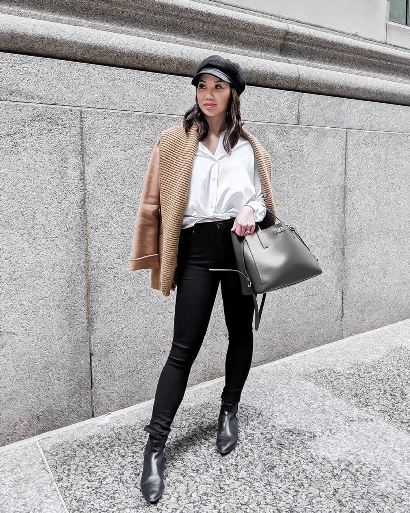 Workwear Office Oufit - white blouse, black jeans, camel coat, and newsboy cap