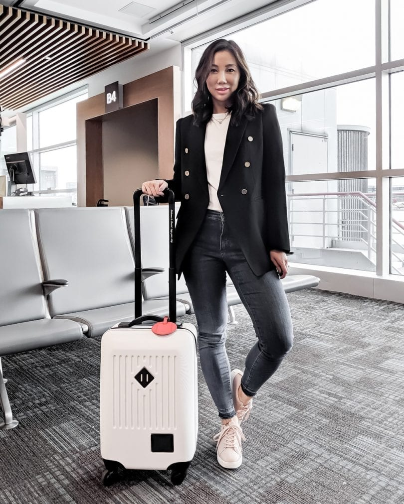 Travel Outfit - jeans and tee with blazer, Herschel carry-on luggage