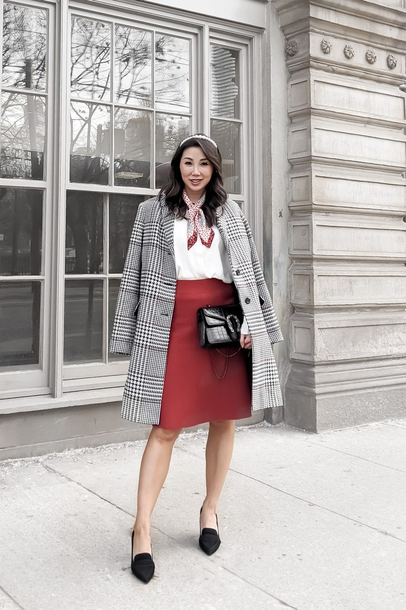 Eileen Lazazzera of YesMissy wears a plaid coat with red skirt and blouse from Ann Taylor