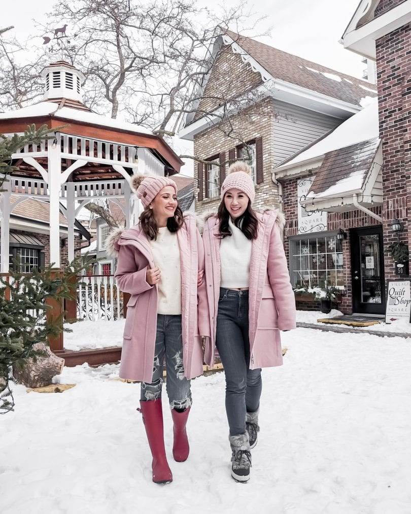 Winter Outfit Ideas - Twinning in pink parks with jeans and sweaters