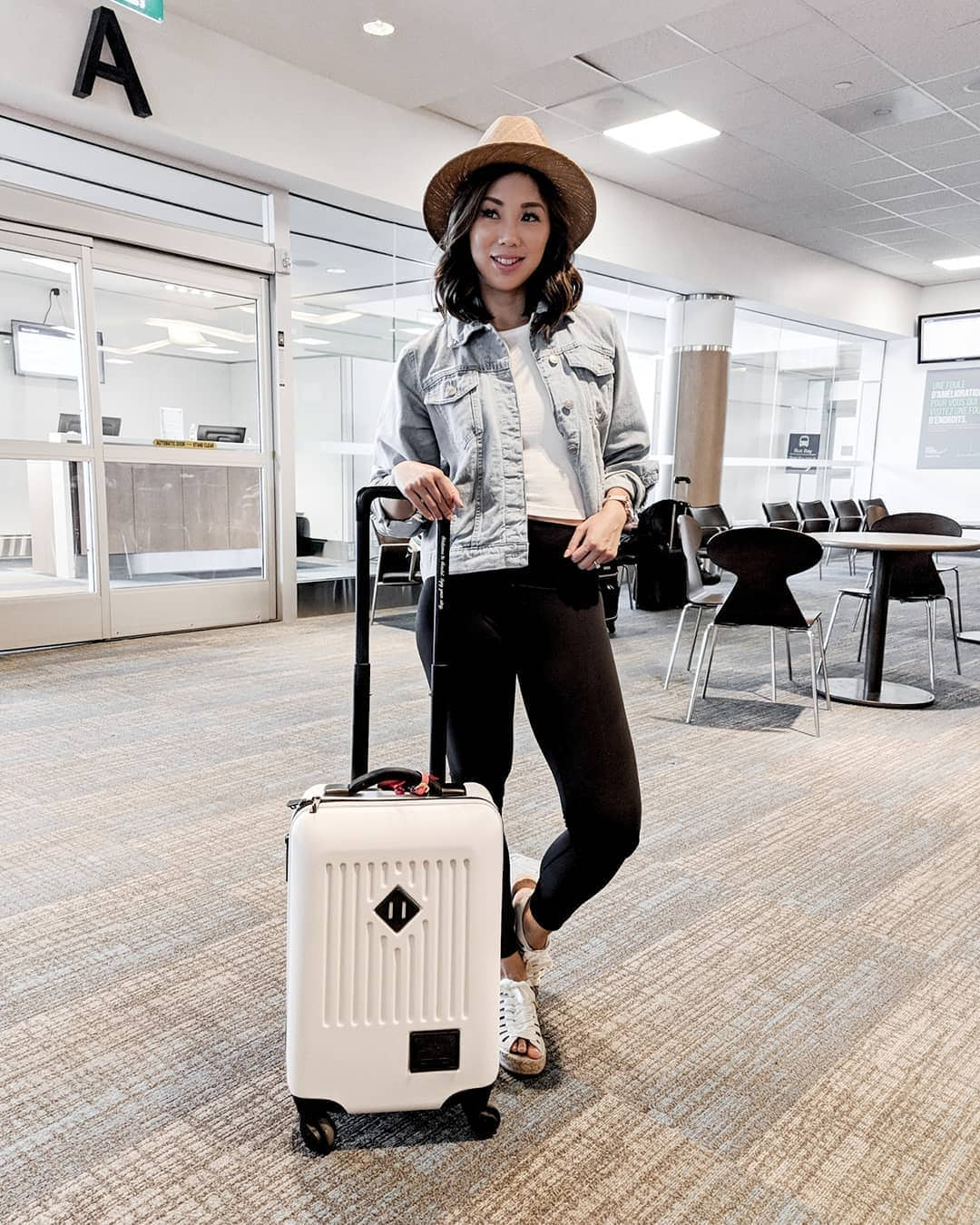 Black leggings outfit for travel with tshirt and jean jacket worn by Eileen Lazazzera of YesMissy