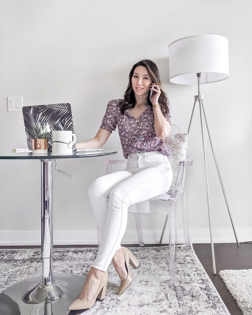 Summer workwear outfit with white jeans and floral top worn by Toronto fashion blogger YesMissy