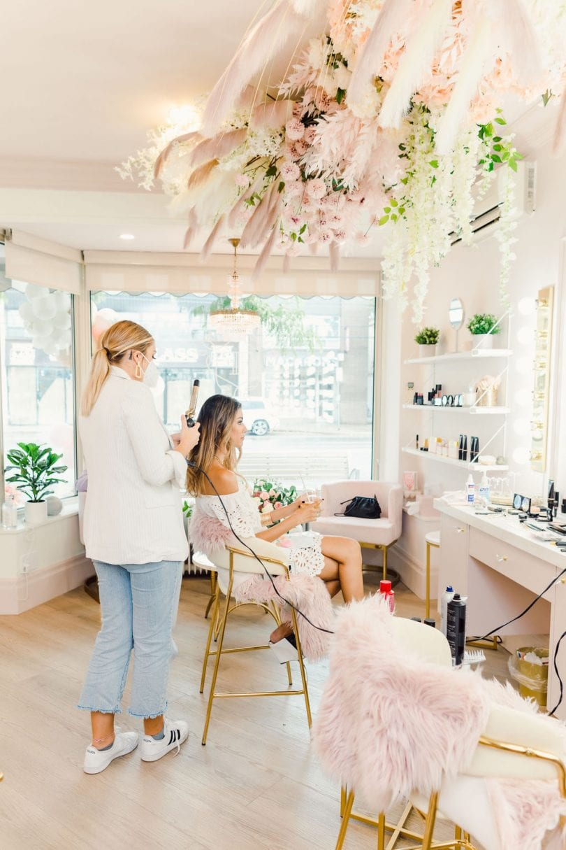 Getting makeup and hair done at the Fancy Face Rosé Room