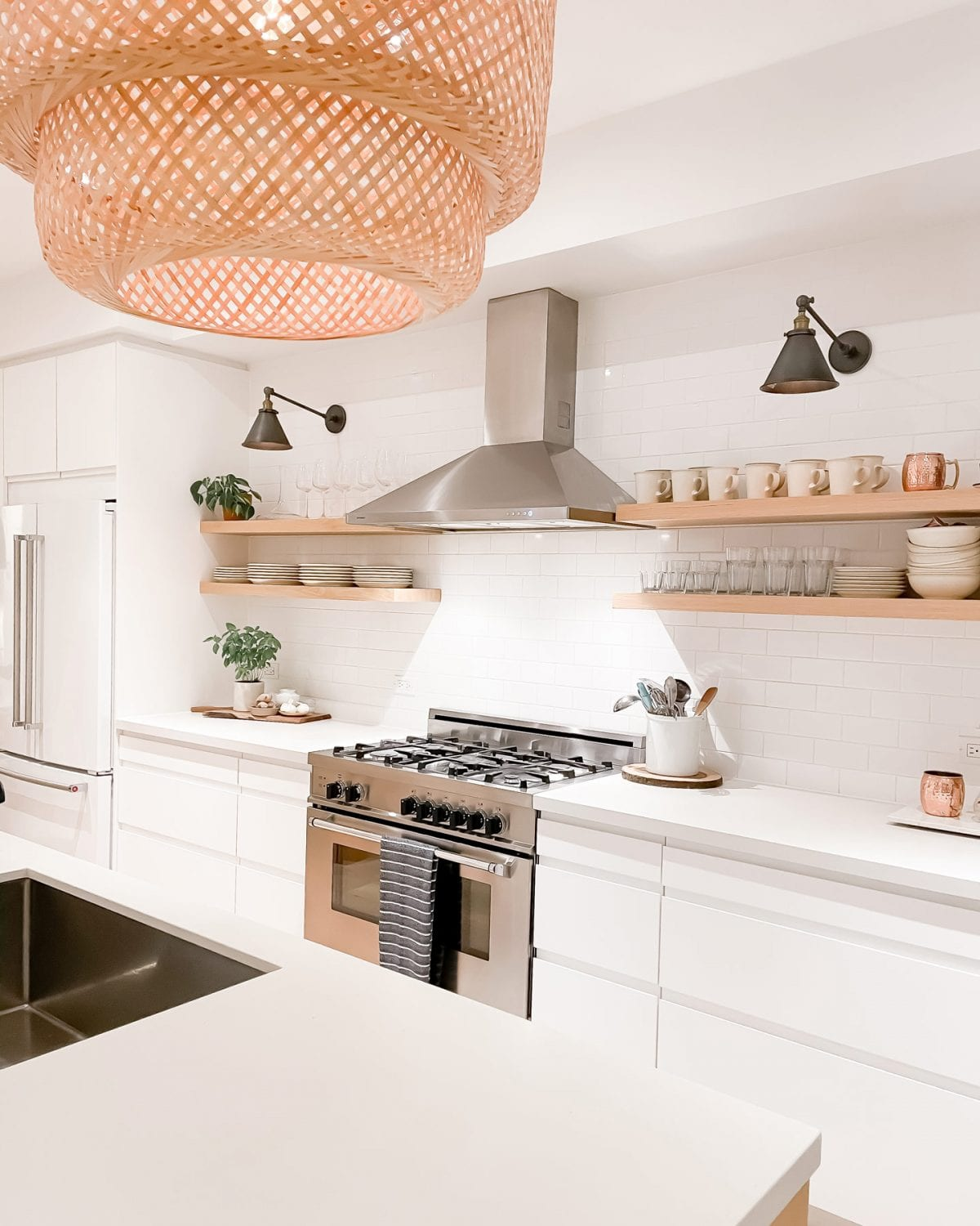 Beautiful renovated kitchen with white counter and wood accents. For more visit yesmissy.com