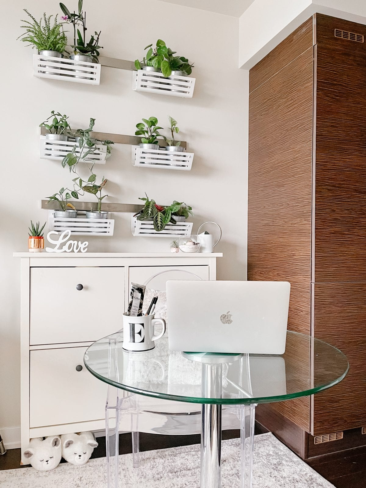 Apartment tour - working area with desk and plant wall