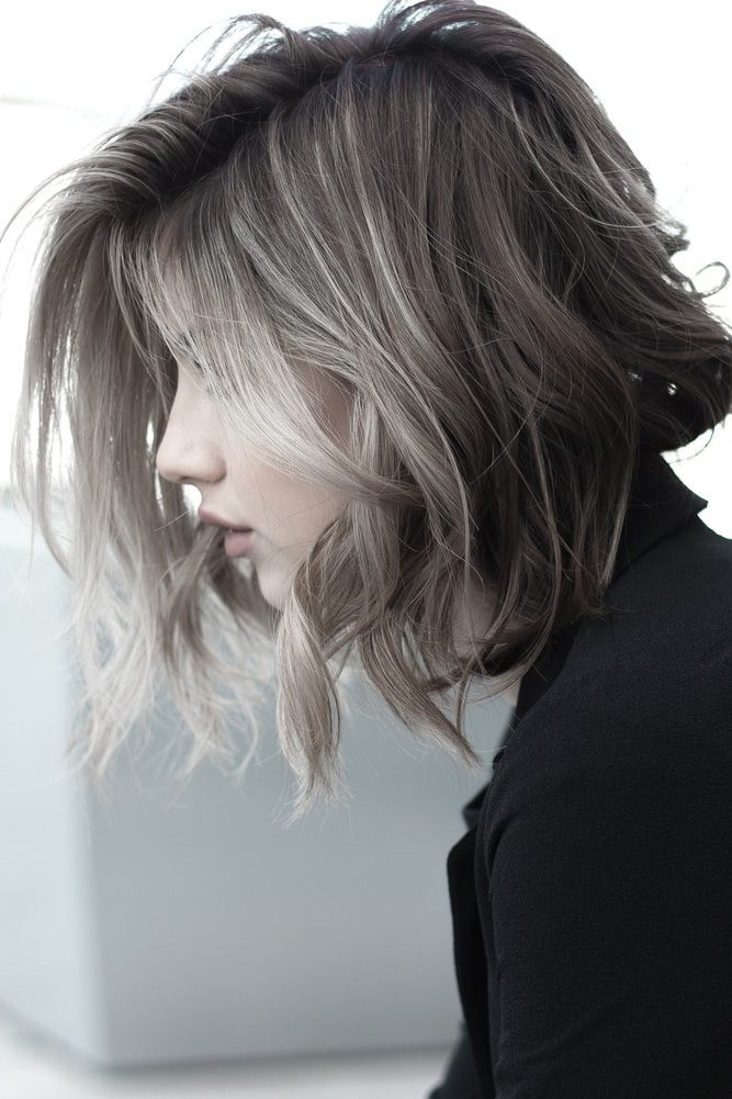 Medium length hairstyles - The contrasting highlights give texture and depth to this lob.