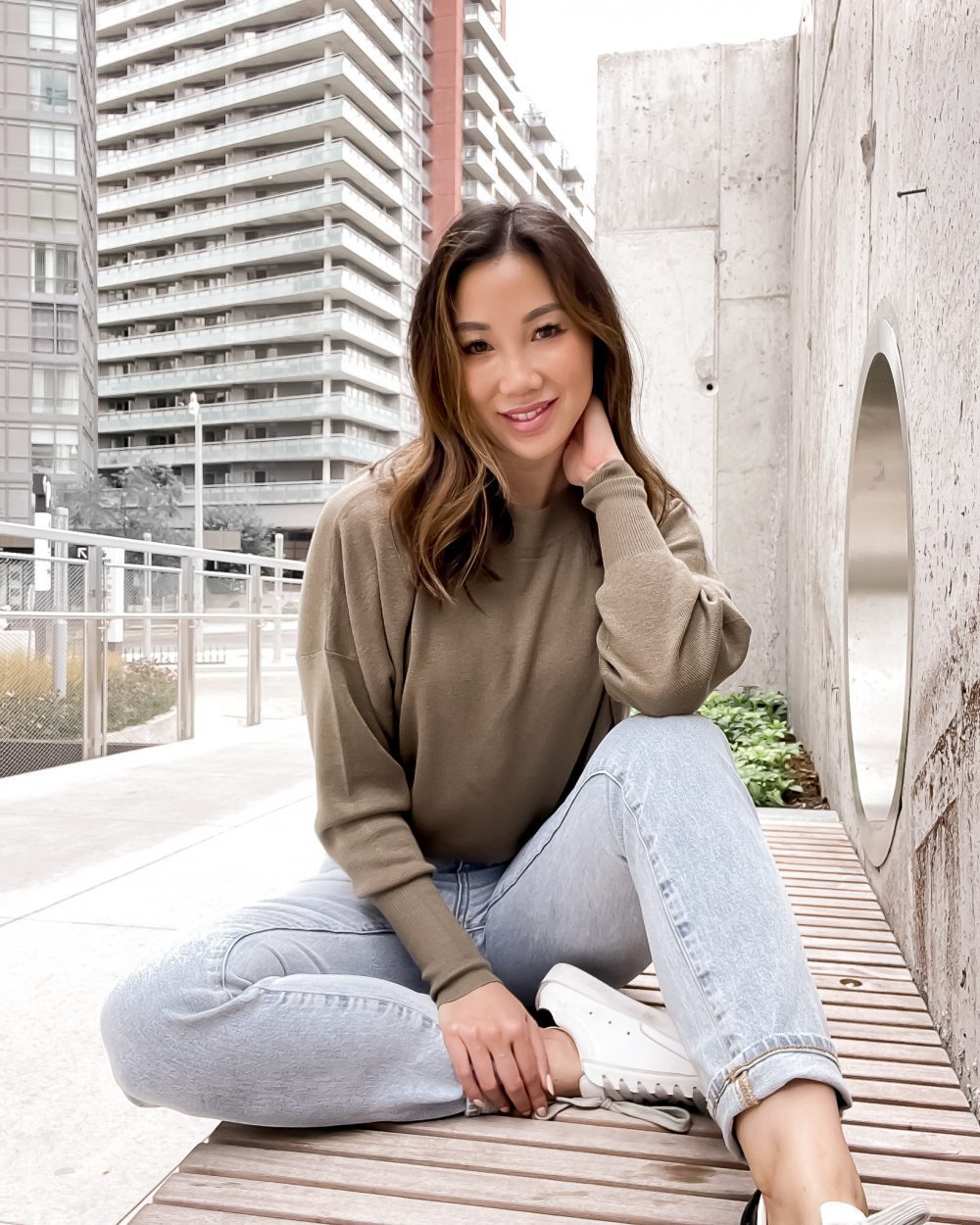 Everyday casual outfit idea for fall - jeans and green sweater from Ever New